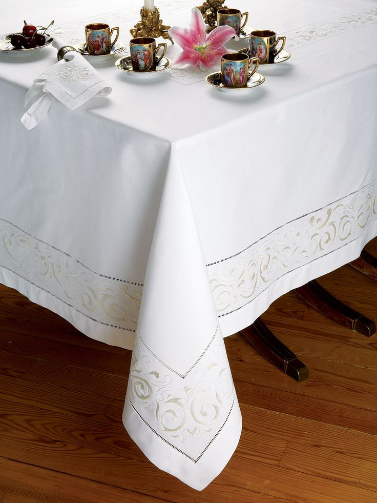 To the manor born, finest 100% linen woven in Italy, is sensitively hand-embroidered with the exquisite subtlety of a White or Ecru scroll motif on White. Fastidiously framed with intricate hemstitching, these imported tablecloths, napkins, placemat sets and cocktail napkins lend an aura of nobility to gracious entertaining.
