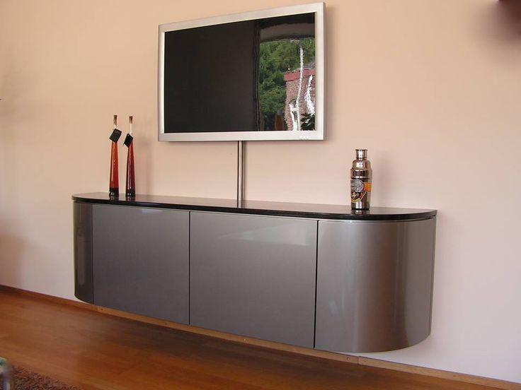 zwevend tv/audio dressoir in metallic lak en afdekblad in graniet uitgevoerd, ontwerp en productie door Kulowany Interier in Hoensbroek.