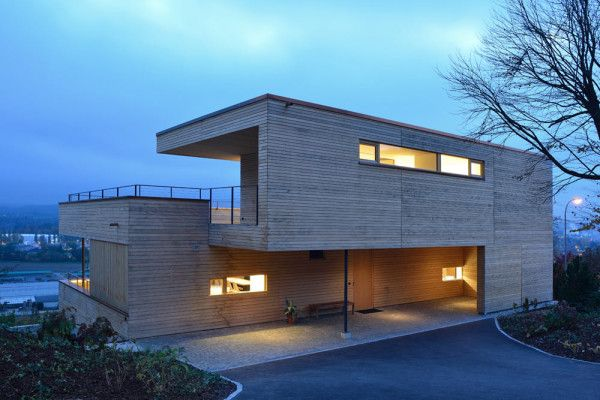 Layered Wood Boxes: Weinfelden House by k_m architektur - Design Milk