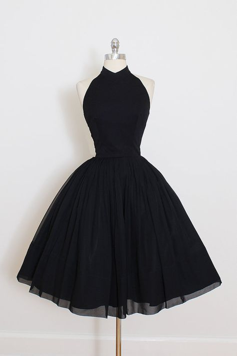 ➳ vintage 1950s dress  * black crepe chiffon * acetate lining * halter bodice * metal back zipper * full skirt  condition | excellent fits like xs/s  length 41 bodice 16 bust 36 waist 26  ➳ shop http://www.etsy.com/shop/millstreetvintage?ref=si_shop  ➳ shop policies http://www.etsy.com/shop/millstreetvintage/policy  twitter | MillStVintage facebook | millstreetvintage instagram | millstreetvintage  4644/1629