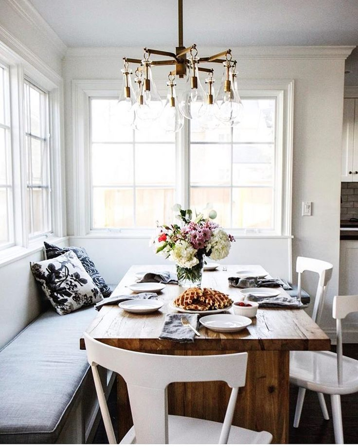 the perfect nook for a long lazy Sunday breakfast from @parkandoakdesign in the #ckstyleaccordingly feed! LOVE that chandelier!