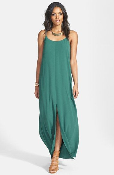 In the Mediterranean, we love flowy yet revealing maxis like this teal green dress.