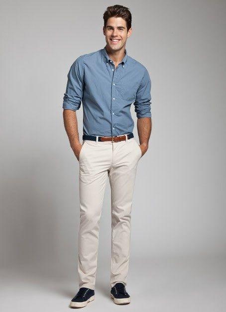 Shop this look on Lookastic:  https://lookastic.com/men/looks/blue-long-sleeve-shirt-beige-chinos-navy-plimsolls-navy-belt/12823  — Blue Long Sleeve Shirt  — Navy Canvas Belt  — Beige Chinos  — Navy Plimsolls