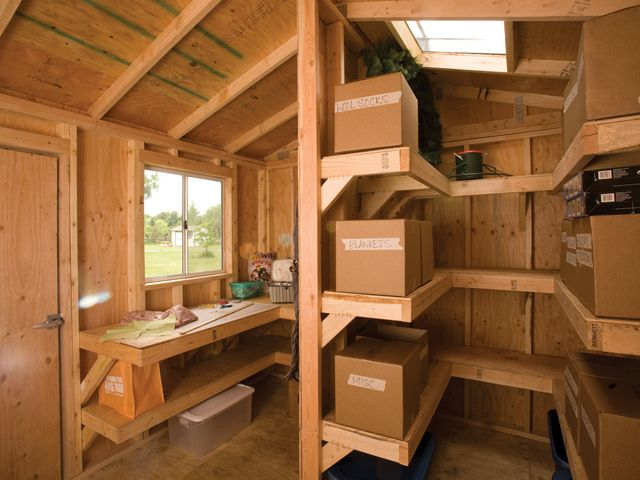 Interior shelving and workbench by tuff shed storage for Shed interior ideas