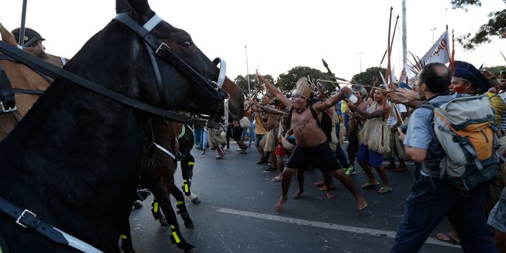 22 Staggering Images Of Brazil's Indigenous Tribes Taking On The Riot Police With Bows And Arrows