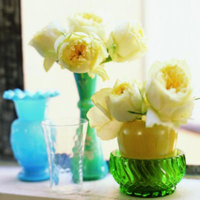 Jewel-tone vases and yellow cabbage roses