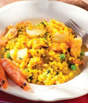 This seafood risotto recipe is infused with a number of fresh herbs, imparting remarkable flavour onto the risotto rice base. - by Shaun Rankin