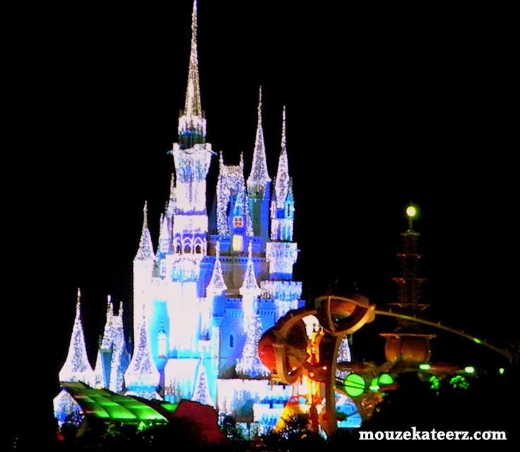 Disney's Cinderella Castle with Tomorrowland Neon