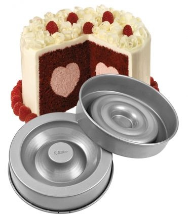 For the perfect #Valentinesday cake. Heart shaped centre cake pan, from Wilton.
