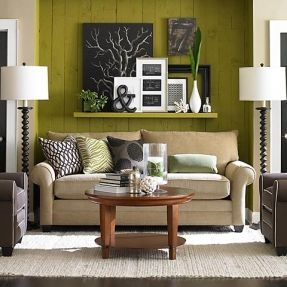 floating shelves above accent chairs | Natural muted palette with a chartreuse accent wall. A floating shelf ...