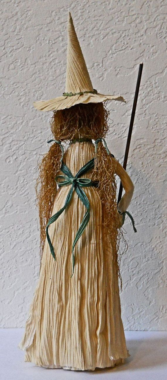 This magical kitchen witch doll was lovingly hand crafted of corn husks with hair of natural corn silks. Her broomstick is made with pine needles