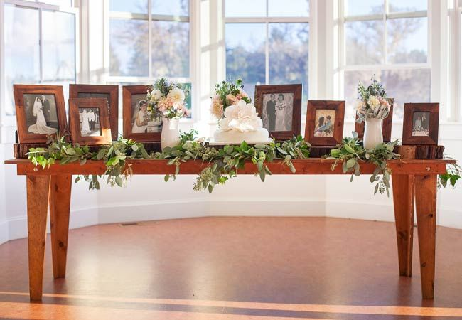 Ways to honor deceased loved ones at your wedding: Set up a memory table at the reception with photos of family and friends who have passed away.
