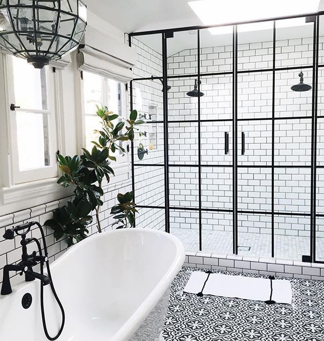 bathroom with black hardware black framed shower doors black and white patterned encaustic tile floor designed by life style la via dream bathroom