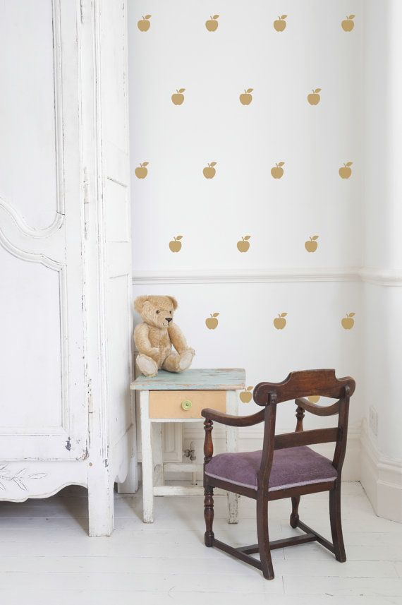 Create a cozy gender-neutral nursery with these adorable apple wall decals.