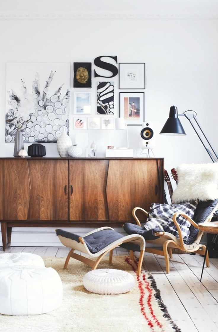 Appealing and cozy reading corner with a graphic collage-look on the wall mixed with an old wooden desk from the 1960's.