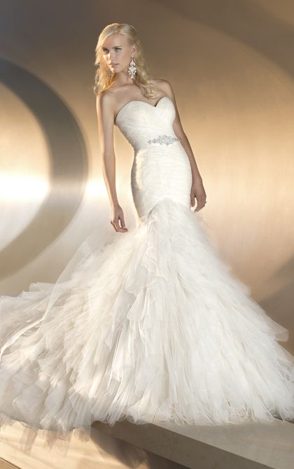 Essense of Australia - Style D1463  This whimsical designer fit-and-flare wedding gown features a bodice with soft lace under tulle and a skirt that blooms with tiered layers down to a court train. Detachable Swarovski crystal beaded sash accentuates the waist. Lace up or zipper back available.