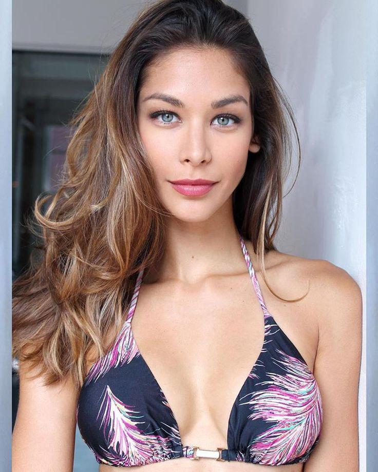Classically pretty Venezuelan model  Dayana Mendoza was Miss Universe 2008.  Bikini top.