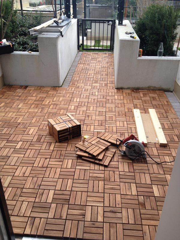 IKEA to the rescue, saving all of us from our drab slab patios. DIY outdoor interlocking patio decking with IKEA Platta.