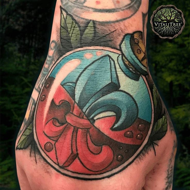 What a cool #jobstopper crushed by @tattoo_trey in July featuring a #roundbottle half filled with #blood and the classical French stylized #lilyflower known as the #FleurDeLis which is also a symbol less commonly known as the emblem of the #trickster archetype. ;) Inked at Trey's shop @RedShoresTattoo in Houston Texas.   #fleurdelistattoo #jobstopper #handtattoo #newschooltattoo #newschool #symbolictattoo #handtattoos #neotradsub #neotraditionaltattoo #neotraditional   #VitaliTreeTattoo…