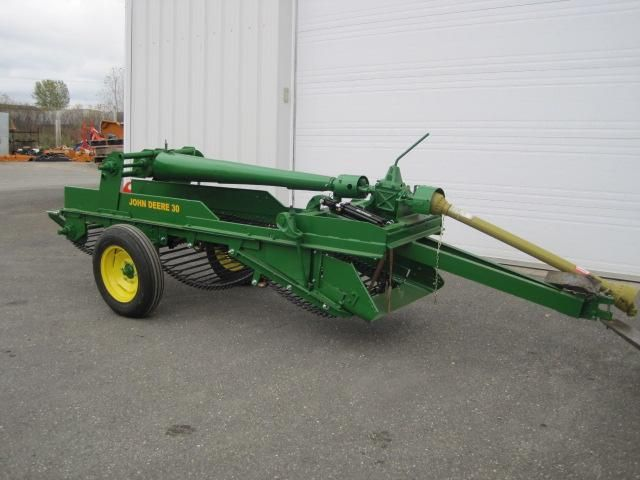 This is a JD 30 1 row potato digger...we had a 2 row...looks the same but wider and dug 2 rows