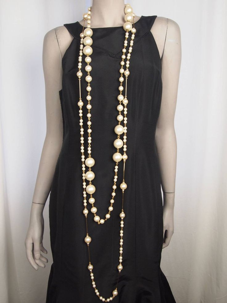 Chanel Long Pearl Necklace Autumn/Winter 2001-2002 | From a unique collection of vintage chain necklaces at https://www.1stdibs.com/jewelry/necklaces/chain-necklaces/