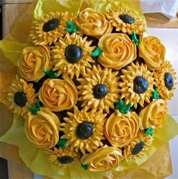 A cupcake bouquet of sunshine yellow bouquet with roses and sunflowers- just to make someone smile