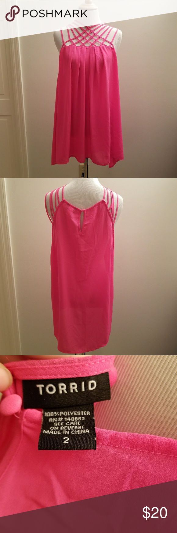 Torrid Hot Pink Strappy Top Size 2 NWOT Condition: New without tags  Brand: Torrid Color: Hot Pink Size: 2  New without tags. Gorgeous hot pink strappy top. Criss crossed front adds a beautiful touch. Can be dressed up or down. torrid Tops