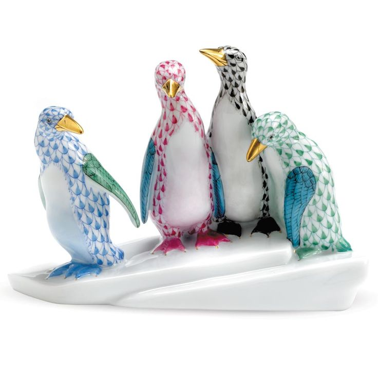 Herend Hand Painted Porcelain Four Penguins on Ice Figurine in blue rasp black green fishnet design w/gold accents.
