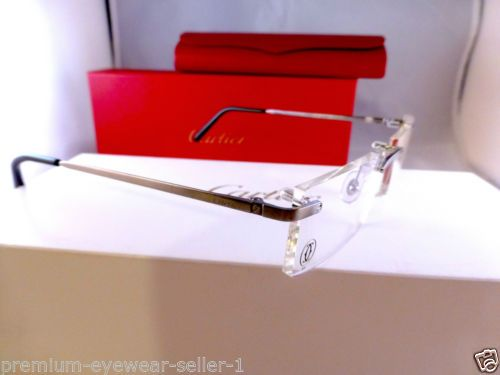 Cartier-T-eye-Titanium-Rimless-eyeglasses-frames-Lunettes-Cartier-modele-T-eye -- Normal European retail price €750 >> OUR PRICE starting at €299 -- http://www.benl.ebay.be/itm/Cartier-T-eye-Titanium-Rimless-eyeglasses-frames-Lunettes-Cartier-modele-T-eye-/301994156724?hash=item46504122b4:g:fTYAAOSwbYZXa-CT