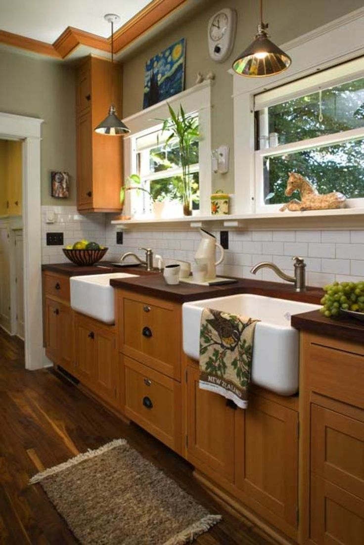 A pair of farmhouse sinks was installed under the windows, with a dishwasher hidden between. (Photos: William Wright)
