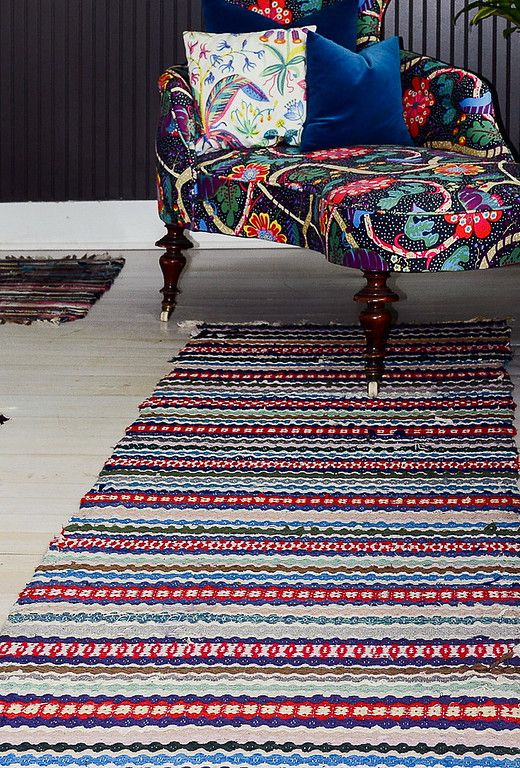 The stunning patina of a vintage Swedish rug brings a feeling of history while still being durable, beautiful and colorful.