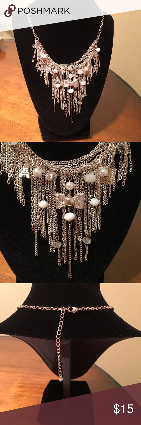 Silver and white statement necklace So pretty! Features silver chains with various charms and pearls dangling. New! Jewelry Necklaces