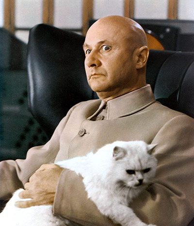 """Credit: Allstar/Allstar Blofeld's Mao suit  (1977) Although not properly immortalised until Mike Myers spoofed it as Dr Evil in the Austin Powers films, the iconic grey Mao suit was first worn by arch villain Blofeld, played by Donald Pleasence in You Only Live Twice. Hemming says: """"The style is sometimes referred to as a Nehru suit, but the turned-down collar and fly front is more Mao –and Pleasence is easily the most villainous wearer of it."""" Blofeld, the head of the criminal…"""