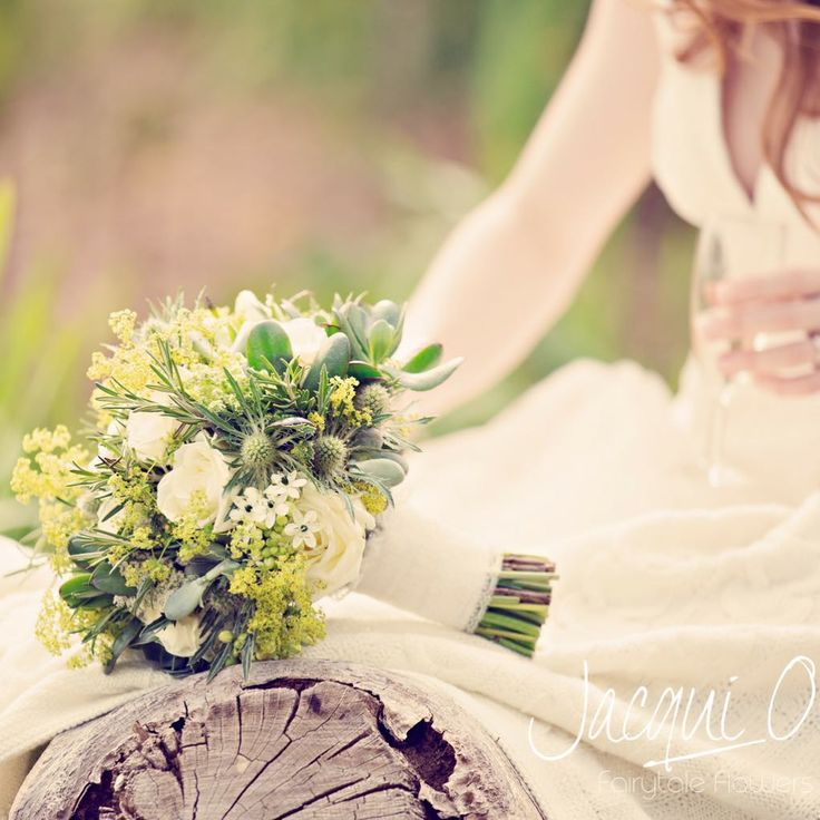 'Avalanche' roses, thistle, ornithogalum bridal hand-tied