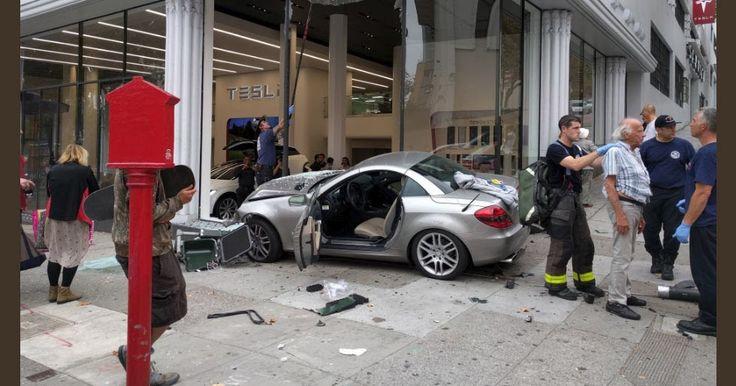 Mercedes SLK Driver Crash Into A Tesla Dealer In San Francisco #Accidents #Mercedes