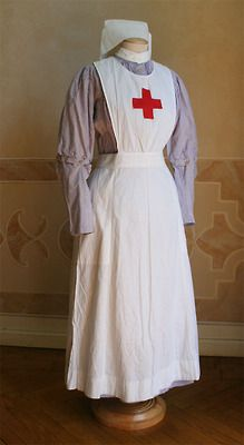 Nurse's uniform of the British Red Cross in World War I, composed of whole dress in lilac striped cotton front with detachable sleeves, aprons stood on the shoulders of buttons, collar, and cuff.