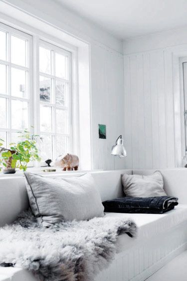 Beautiful Danish Summerhouse - a cosy window seat bathed in natural light.