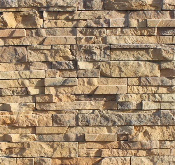 Exterior dry stack stone natural rocks construction for Stacked stone house