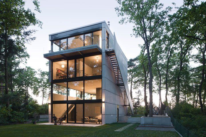 Modern single family house designed by Peter Ruge Architekten is located in a beautiful small village in the district Potsdam-Mittelmark, Germany.