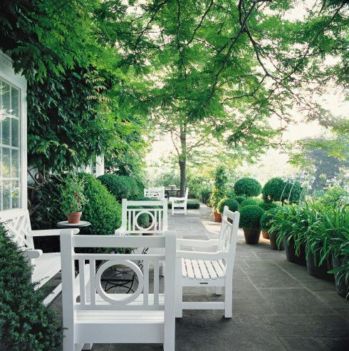 This is one of my favorite styles of outdoor furniture, this seating area was repeated down the patio.  Just beautiful, green & white.