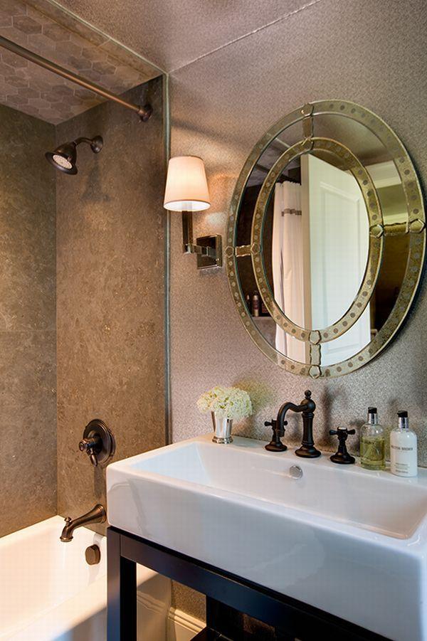 Elegant Bathroom With A Strong Statement Venetian Mirror