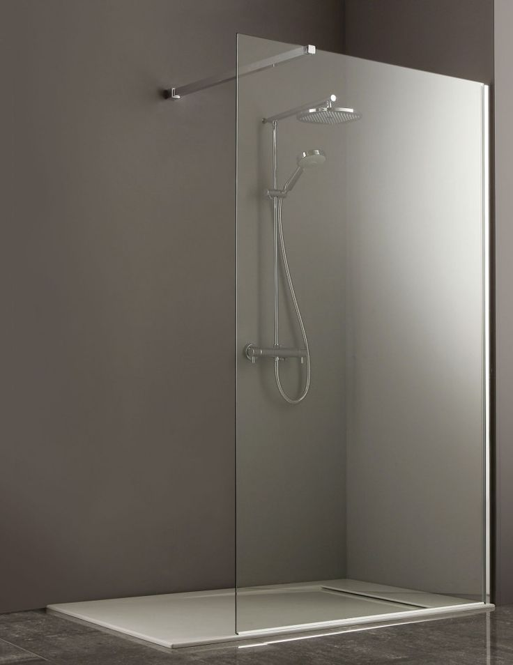 Glass Shower Room With Stainless Steel Shower On The Wall
