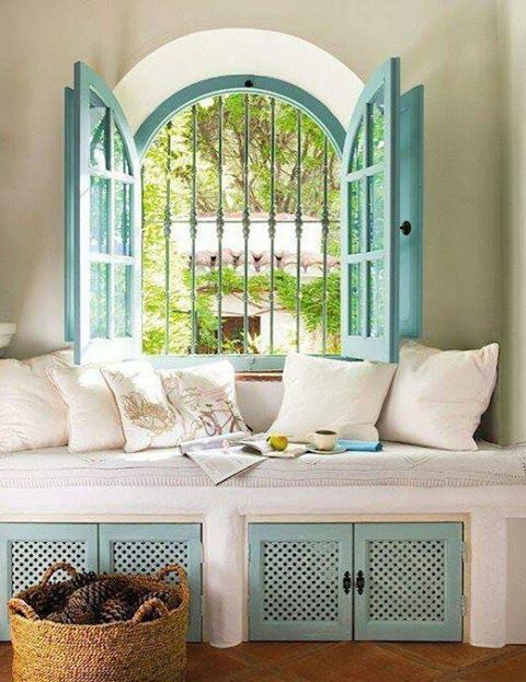 """Moorish green (also goes by """"Spanish Green"""") doors and shutters on Spanish Revival home."""