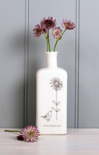 Large flat backed bottle based on a medicine bottle shape perfect for the simple garden dickie bird illustration.  Great for a small posy of flowers.