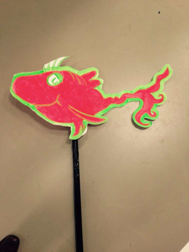 Fish for Jojos song.  Painted onto blue board with glow in the dark fluorescent paint.  Attached to a pvc pipe covered in black tape