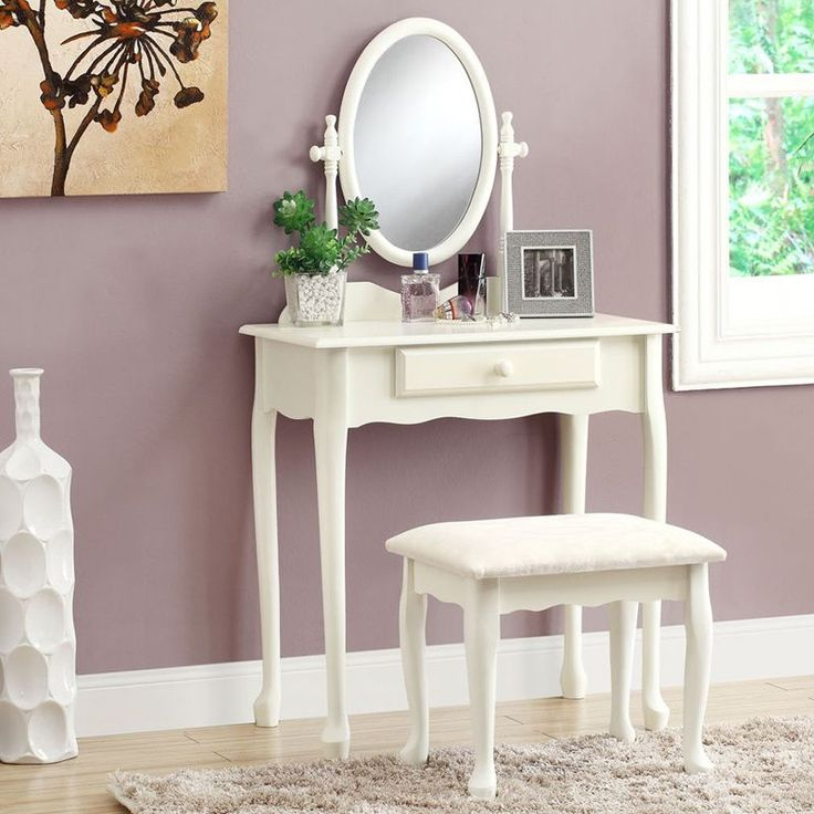 This 2-piece set includes a traditional vanity table with a coordinating stool, both finished in antique white. This set includes an oval swiveled mirror, a single drawer, and beautiful cabriole legs.