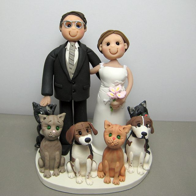 Wedding cake topper cats and dogs by Clayin' Around, via Flickr...would have to be a huge topper to fit our zoo on it!