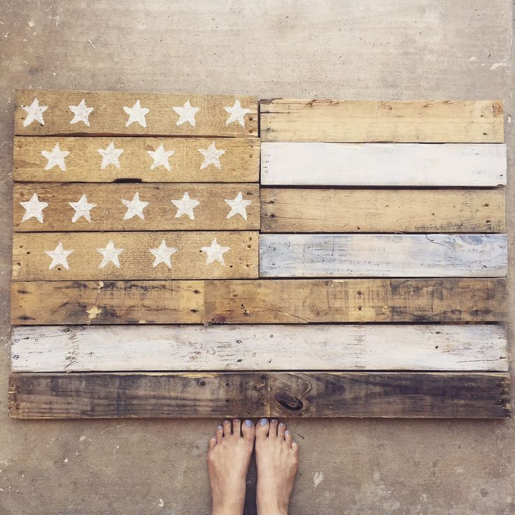 Here's a Step By Step for how we made this adorable shabby chic flag out of a pallet!  What You'll Need: -Pallets(s) {I ended up using wood from 3 since some pieces split or were not great to start with} -Nail Gun/Staple Gun/ Brad Gun for connecting the wooden planks together -Wire and nails (for making a spot to hang on your wall) -Paintbrush (1 Large and 1 small) -White wood stain  -Kitchen Sponge -Scissors  Step One: Break apart pallets.      (the green bucket is full of all the scraps…