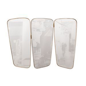 Wilde is a beautifully designed vanity wall mirror. It features three panels and an irregular shape with a golden strap of plated brass that evokes a mid-century modern style while adding a hint of refinement to any interior. It can be hanged above a sideboard or a console and still give that retro look to your bedroom or living room.
