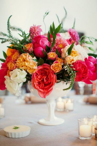 Bright floral centerpiece: www.stylemepretty...   Photography: Ashleigh Taylor -...